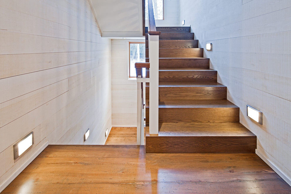 Inspiration for a rustic wooden u-shaped staircase remodel in Toronto