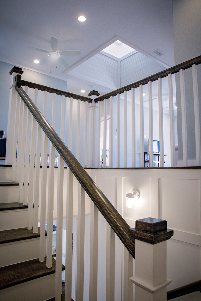 Example of a mid-sized country wooden u-shaped wood railing staircase design in Dallas with painted risers