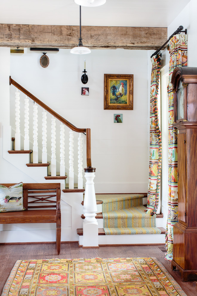 Example of a classic wooden l-shaped staircase design in Other with painted risers