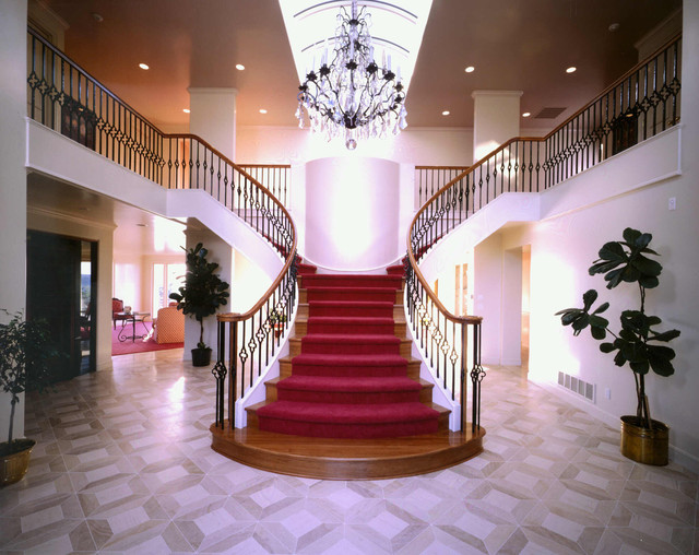 sweeping grand traditional staircase portland by ForArvida Decoration Inc