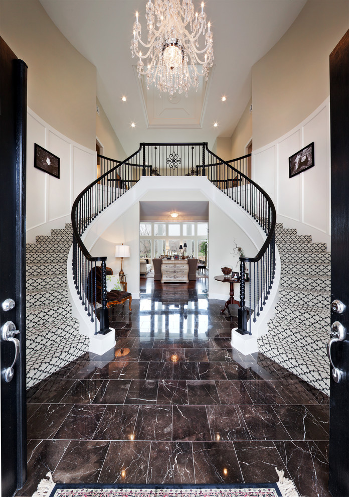 Example of a classic carpeted curved staircase design in Kansas City with carpeted risers