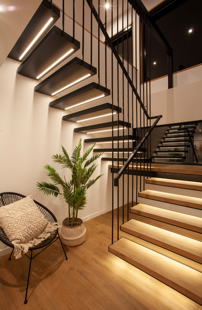 Contemporary wood u-shaped staircase in Hobart with open risers and metal railing.