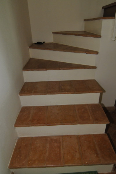 Terracotta Floors traditional-staircase