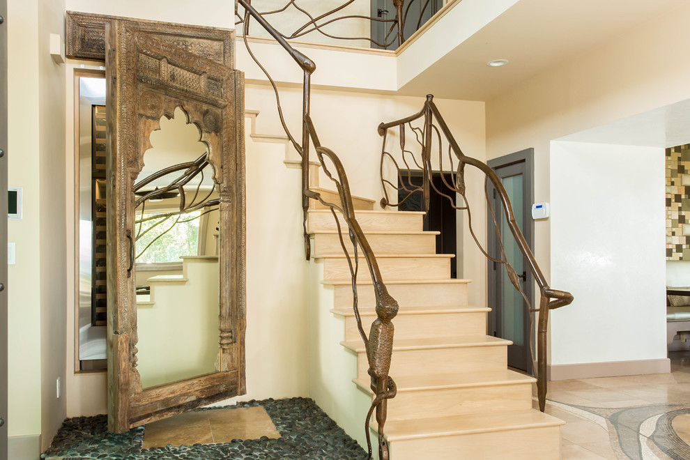Example of a large eclectic wooden l-shaped staircase design in Los Angeles with wooden risers