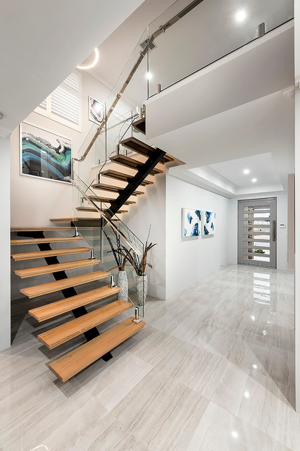 Inspiration for a mid-sized contemporary wood u-shaped staircase in Perth.