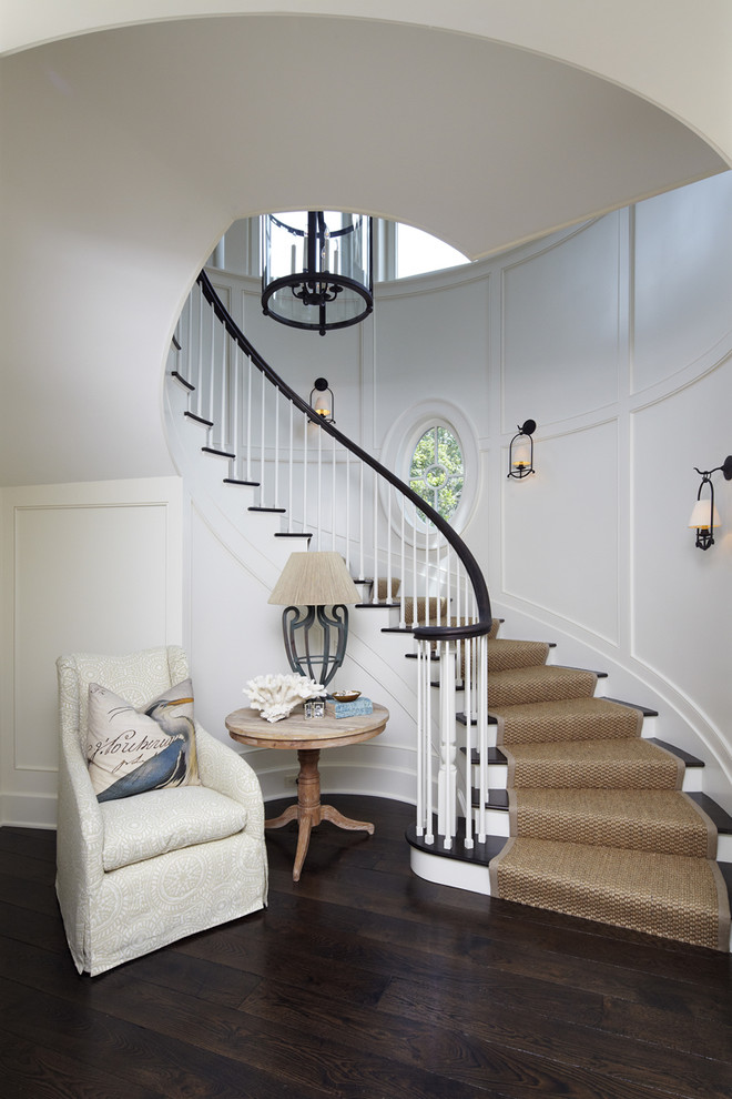 Inspiration for a beach style wooden curved staircase remodel in Charleston