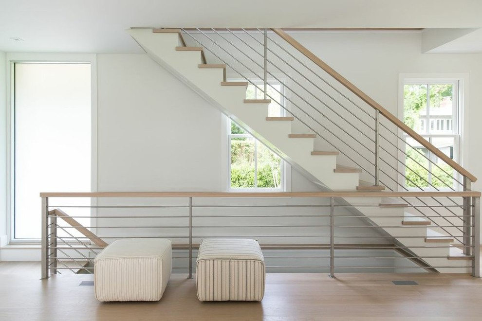 Example of a trendy wooden straight mixed material railing staircase design in New York