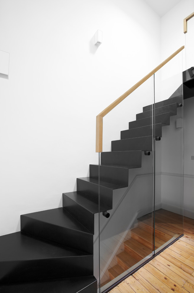 Example of a trendy curved staircase design in London