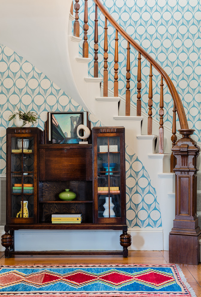 Staircase - transitional carpeted curved wood railing staircase idea in Boston with carpeted risers