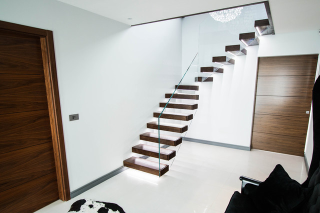 The walnut treads floating staircase with led lights for Free floating stairs