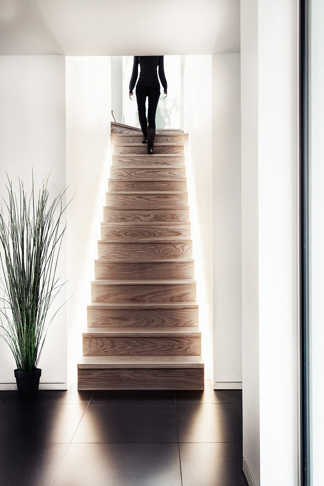 Example of a trendy wooden staircase design in Hampshire with wooden risers