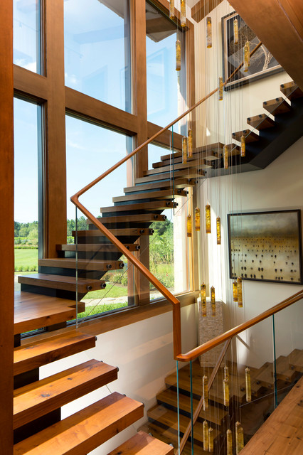 Three Story Floating Wood And Steel Entry Staircase
