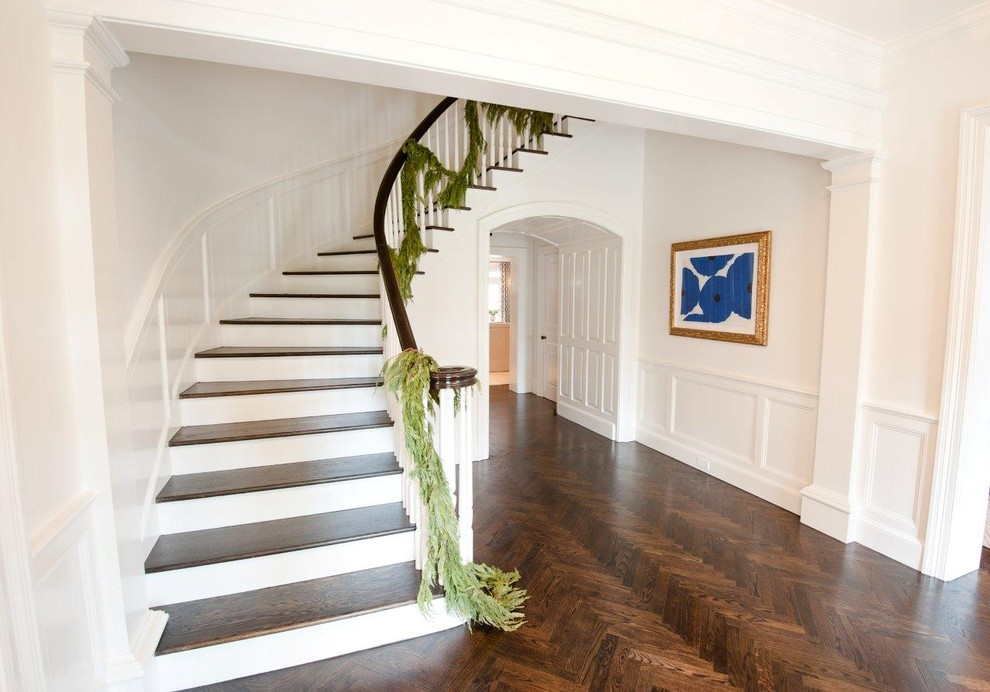 Example of a classic wooden curved staircase design in Houston