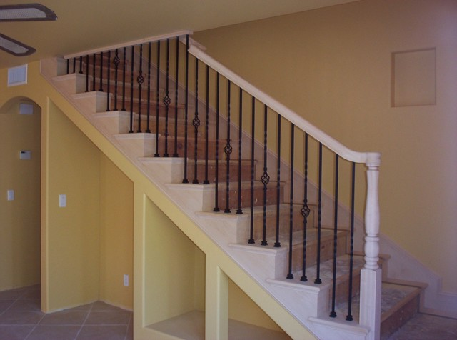 Traditional Maple Staircase With Iron Balusters