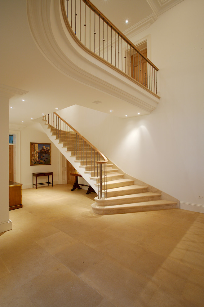 Inspiration for a huge timeless curved staircase remodel in Other