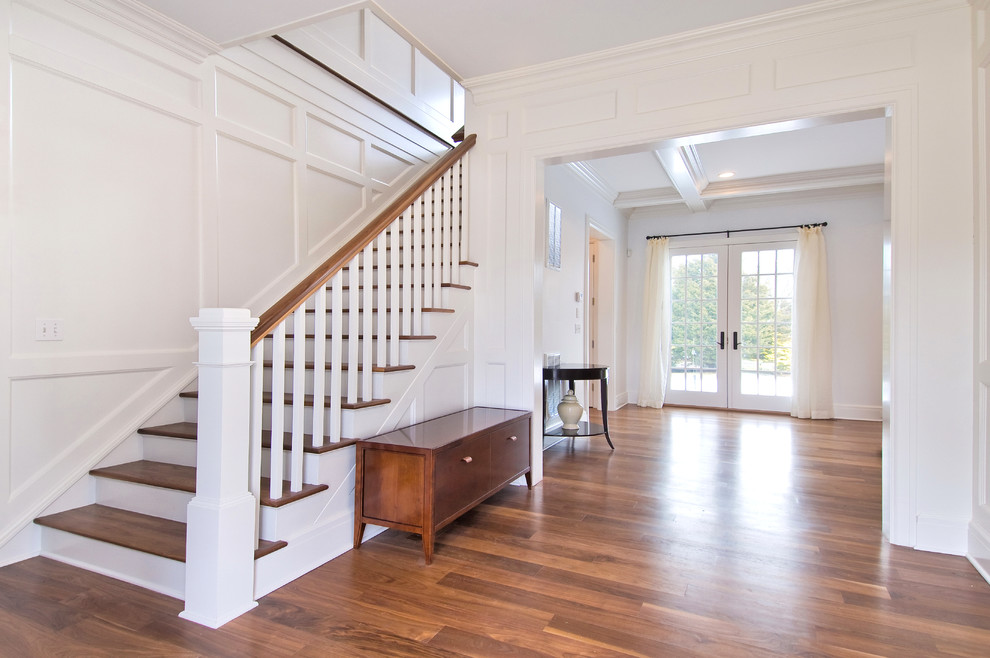 Elegant wooden wood railing staircase photo in New York