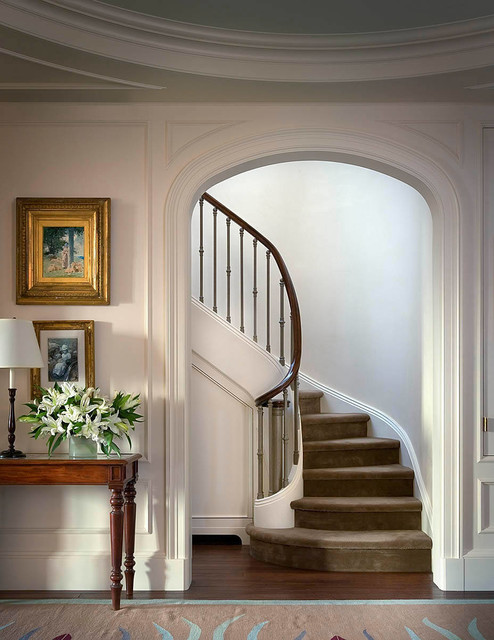 Staircase - traditional carpeted curved staircase idea in New York with carpeted risers