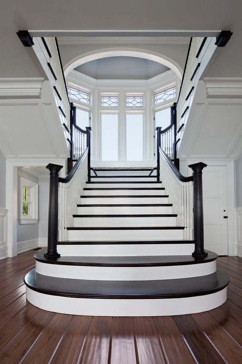 elegant staircases created with contrasting white paint and dark stained wood treads