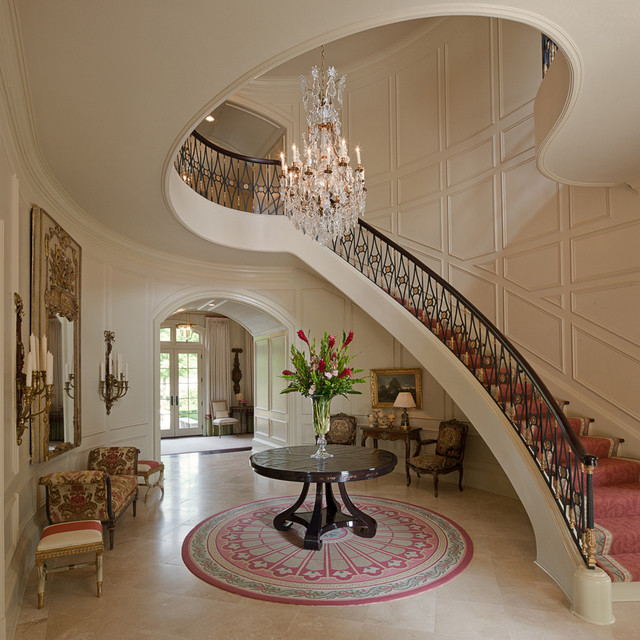 Example of a classic curved staircase design in Atlanta