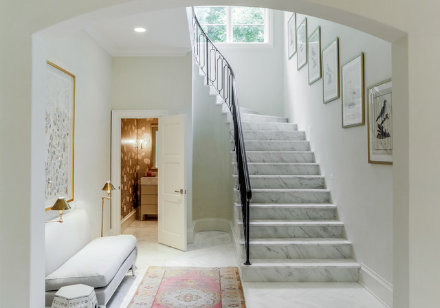 Transitional marble curved metal railing staircase photo in Dallas with marble risers