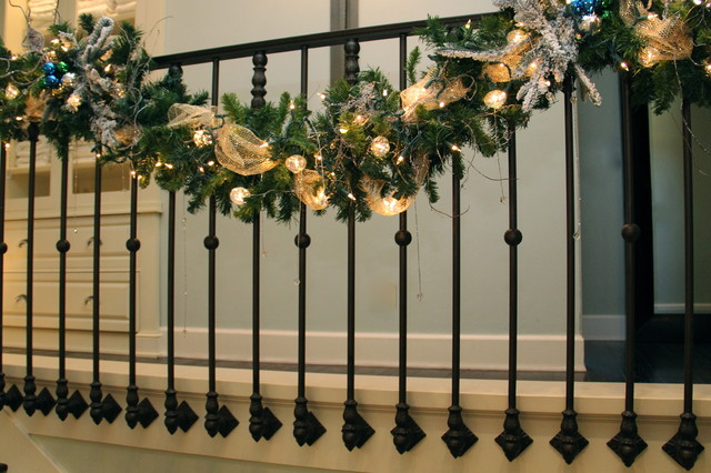 My christmas stair garland transitional staircase for Stair railing decorated for christmas