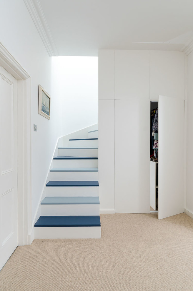 Trendy painted staircase photo in Other