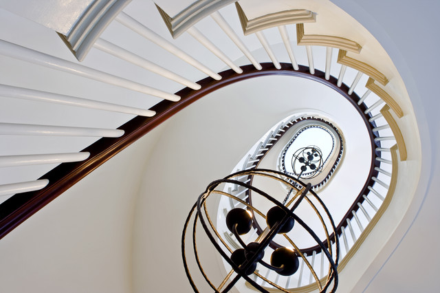 Upward into the spiral stair traditional-staircase