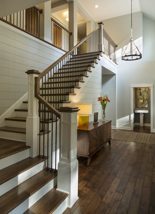 Transitional Staircase by Minneapolis Architects & Building Designers Charlie & Co. Design, Ltd