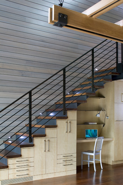 Example of a trendy wooden straight staircase design in Denver with metal risers
