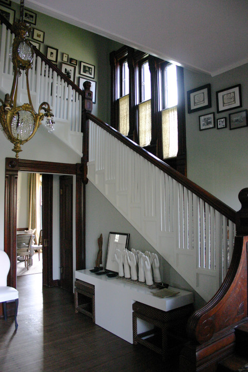 With a two story foyer where the stairs are illuminated with wall ...