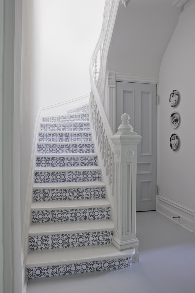 Inspiration for a mid-sized victorian wooden u-shaped staircase remodel in Montreal with tile risers
