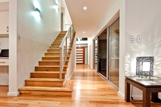 Great view of the timber staircase and view through to the entry door