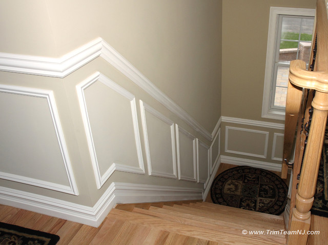 wainscot and picture frames contemporary staircase