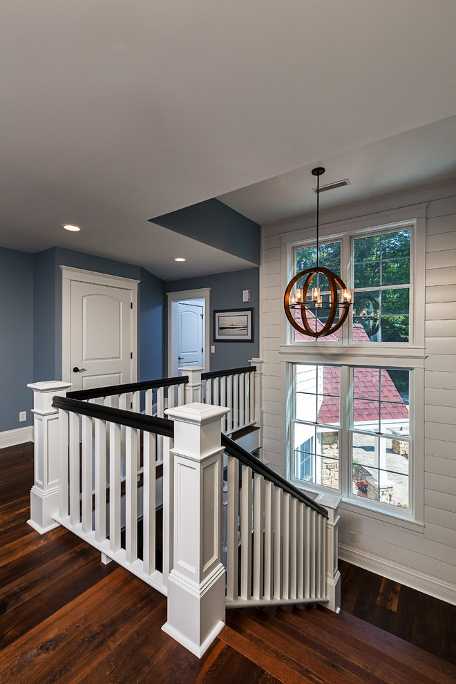 Inspiration for a mid-sized cottage wooden u-shaped staircase remodel in Grand Rapids