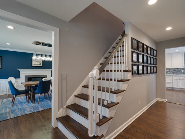 Staircase - mid-sized traditional wooden straight wood railing staircase idea in Philadelphia with wooden risers