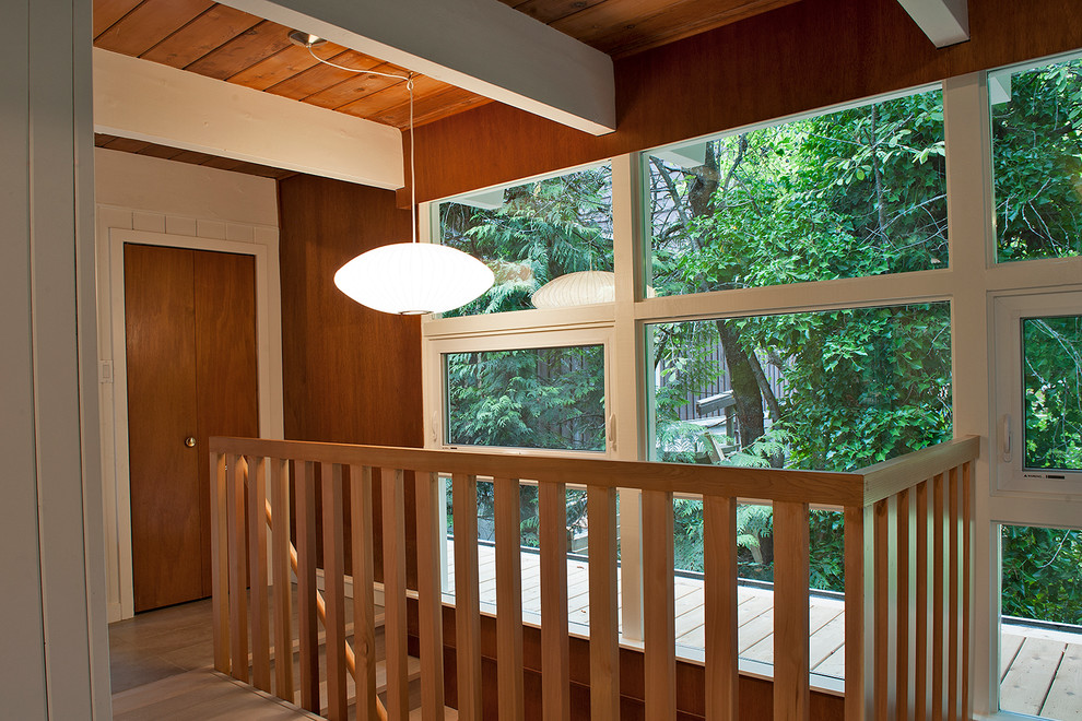 Example of a mid-sized mid-century modern wooden straight staircase design in Vancouver with wooden risers