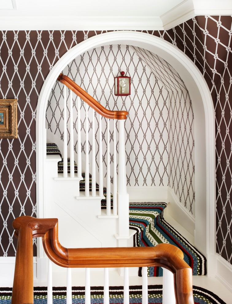 Coastal painted staircase photo in New York