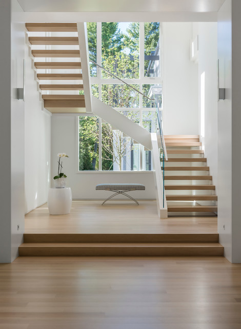 Inspiration for a large modern wooden u-shaped open staircase remodel in Boston