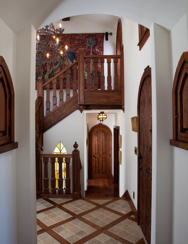 Elegant wood railing staircase photo in San Diego