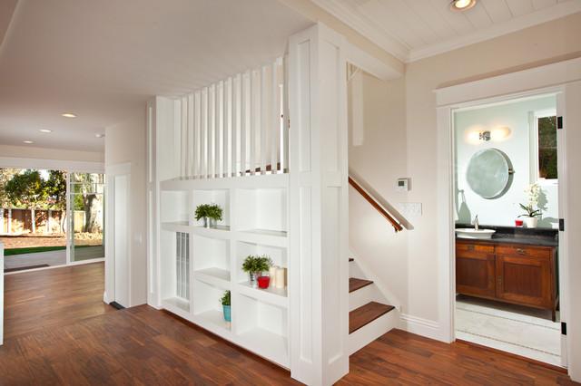 White Kitchen with wood island, carrara backsplash, black granite craftsman-staircase