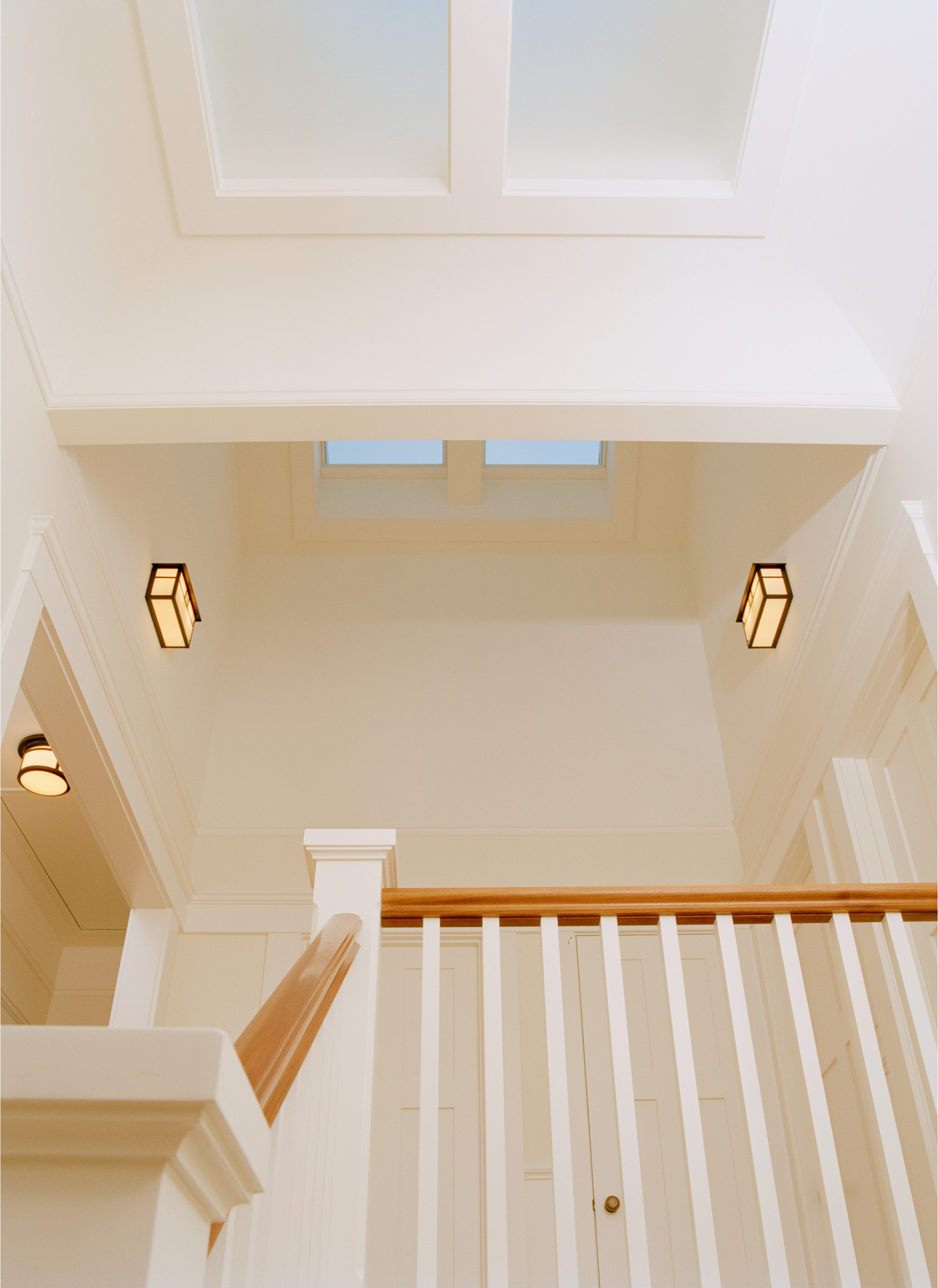 White stairs with skylights above