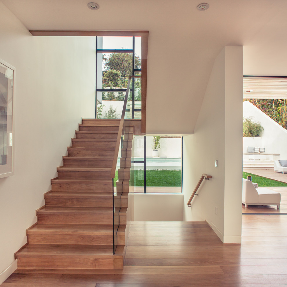 Staircase - large contemporary wooden u-shaped staircase idea in Los Angeles with wooden risers