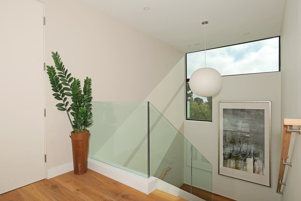 Example of a large minimalist u-shaped staircase design in Los Angeles