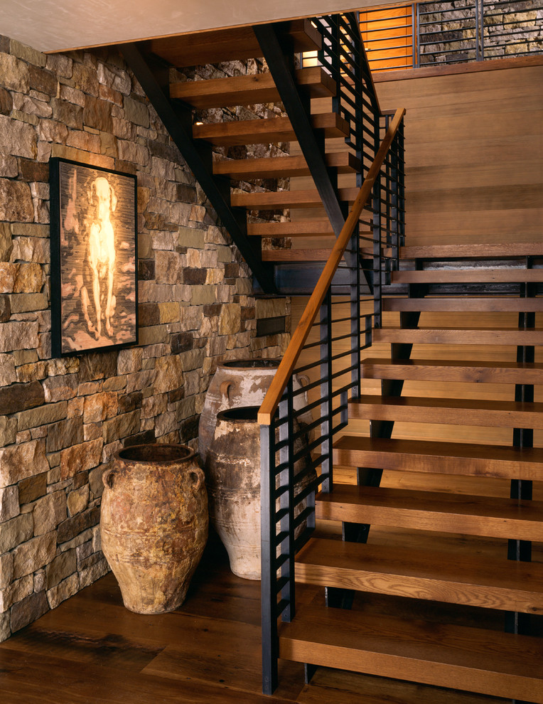 Inspiration for a mid-sized rustic wooden u-shaped open and mixed material railing staircase remodel in Denver