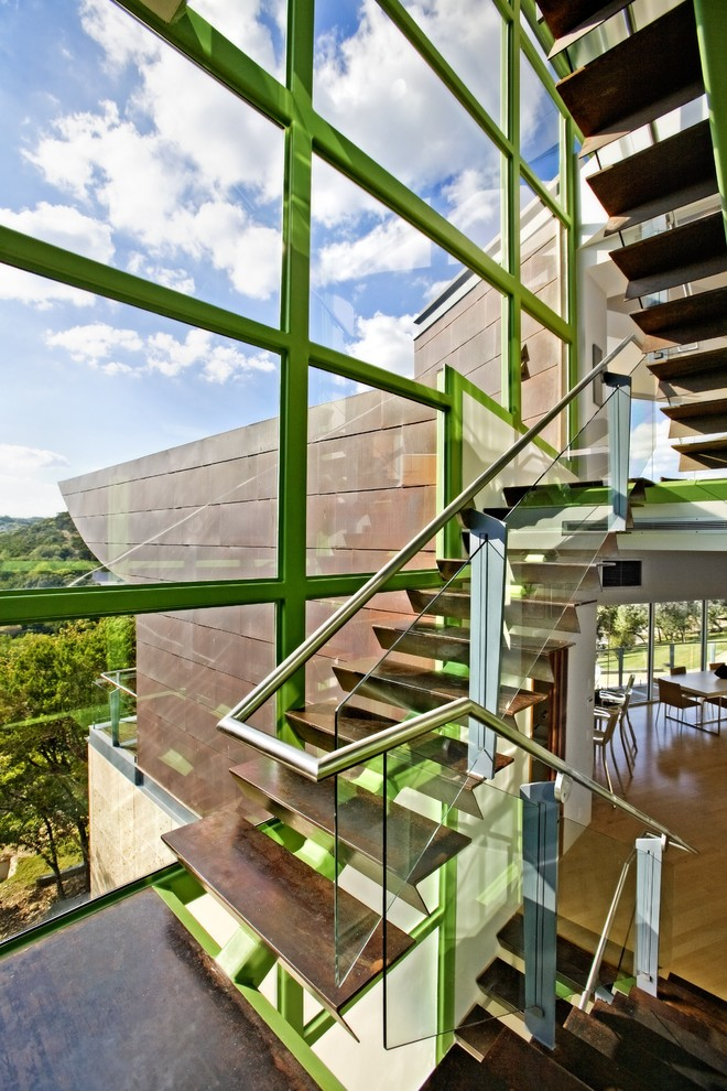 Inspiration for a mid-sized industrial wooden u-shaped open and glass railing staircase remodel in Austin