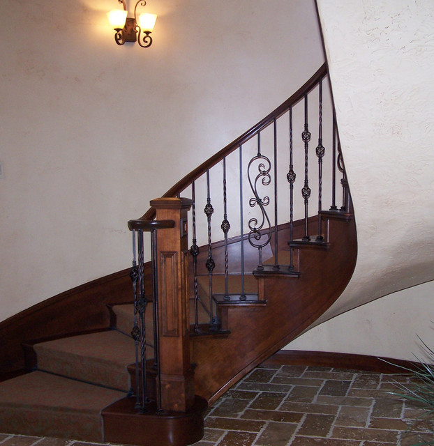 Example Of A Large Classic Wooden Curved Staircase Design In Salt Lake City