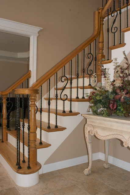 Wrought iron baluster upgrade traditional-staircase
