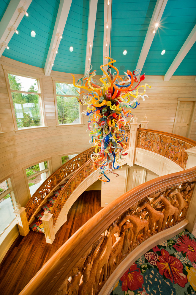 Staircase - large eclectic wooden curved wood railing staircase idea in Other