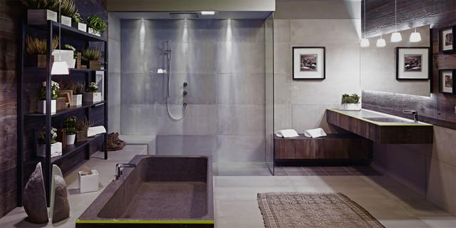 Idee per una stanza da bagno industriale con lavabo integrato, nessun'anta, top in cemento, vasca freestanding, doccia aperta, piastrelle grigie, piastrelle di cemento, pareti grigie, pavimento in cemento e doccia aperta