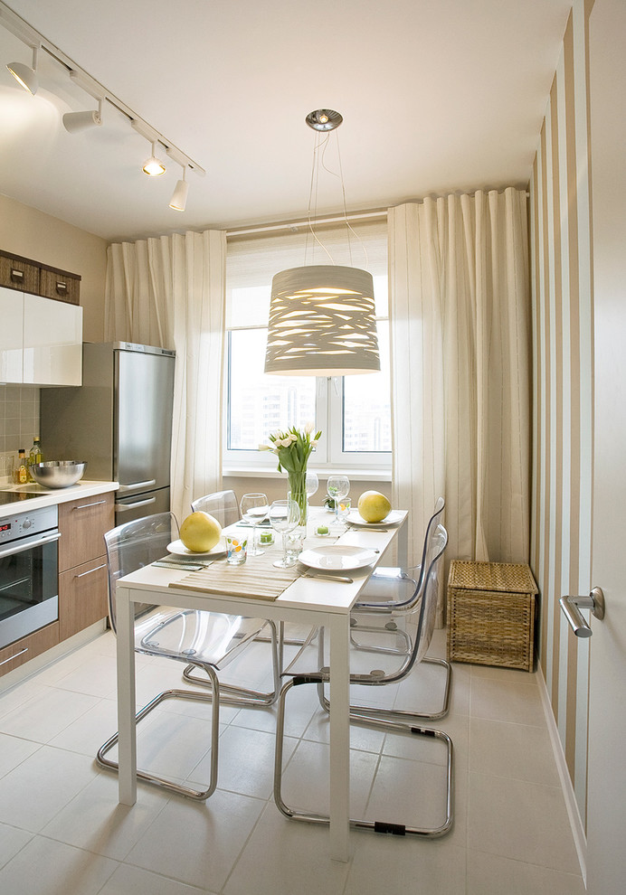 Mid-sized trendy kitchen/dining room combo photo in Moscow with white walls